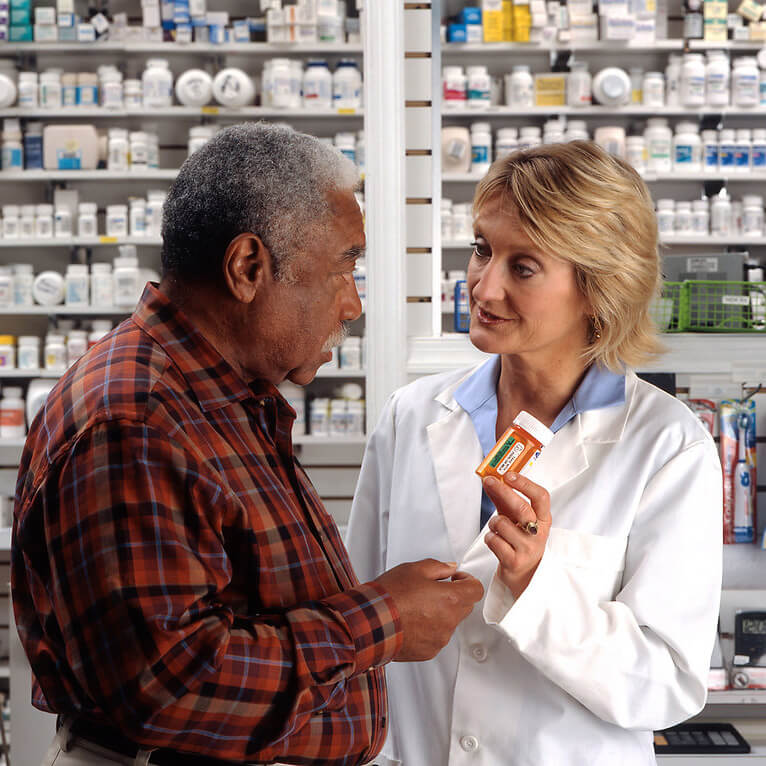 Man consulting with pharmacist